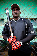 Ronier Mustelier, a 22-year-old member of the Warriors baseball team who defected from Cuba for a chance at the major leagues, poses for a portrait on Thursday, February 25, 2010 in San Antonio de Guerra, Dominican Republic.