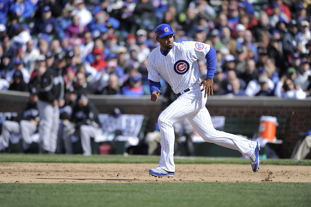CHICAGO - APRIL 15:  Derrek Lee #25 of the Chicago Cubs runs toward second base against the Colorado Rockies on April 15, 2009 at Wrigley Field in Chicago, Illinois.  All players wore number 42 on this day only in honor of Jackie Robinson.  The Rockies defeated the Cubs 5-2.  (Photo by Ron Vesely)