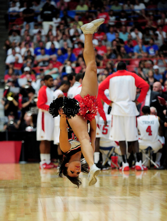 Mar 19, 2011; Tucson, AZ, USA; San Diego State Aztecs cheerleader performs during a timeout during the third round of the 2011 NCAA men's basketball tournament at the McKale Center. The Aztecs defeated the Owls in double over time 71- 64.  Mandatory Credit: Jennifer Stewart-US PRESSWIRE..
