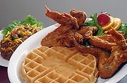 Twiams Chicken and Waffles family restaurant at 2517 Dixie Hwy.&amp;#xD;Food item: Number three special: Four deep fried whole jumbo chicken wings and one Twiams Belgian waffle, with a deep fried potato.&amp;#xD;(Woman with menus) Debra Williams, Tony Williams' mom.&amp;#xD;(Female server) Octavia Wright, 16, a server at Twiams.&amp;#xD;AND WHO IS THAT GUY TO THE RIGHT?<br />
