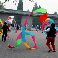 Asia, China, Beijing. Traditional Chinese Riboon Dancers at the Temple of Heaven Park in Beijing.