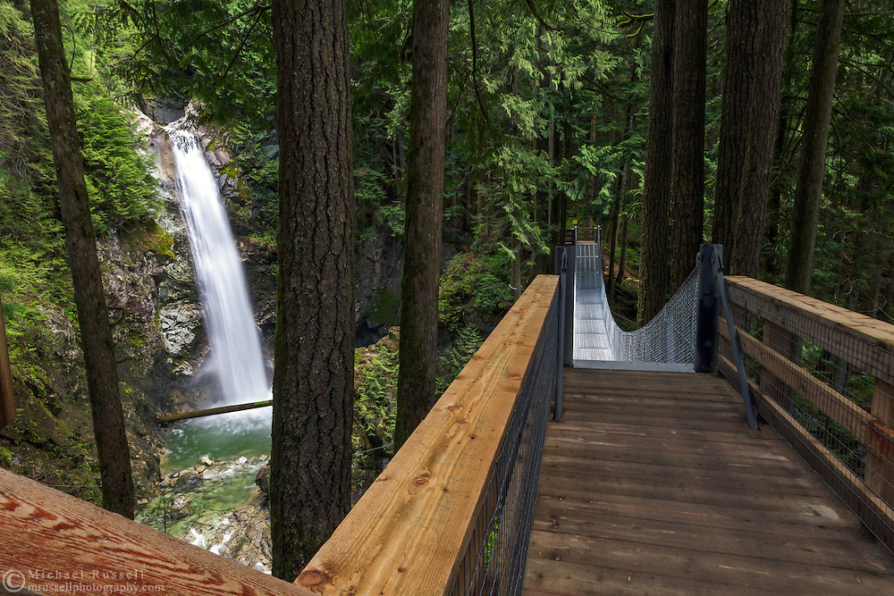 Cascade Falls and the suspension bridge in Cascade Falls Regional Park near Mission, British Columbia, Canada