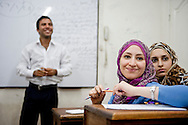 Members of the Tadawo Association, an NGO in Cairo, meet in a classroom to discuss upcoming volunteer projects in Cairo, on September 25, 2011.  The group of 200 of students from various universities take on projects in health and social care working to provide medical assistance to those who can't afford it to help those that the government will not, according to group leaders.   Ann Hermes/© The Christian Science Monitor 2011