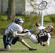Dane Wakefield, left, of John S. Burke Catholic hits James I. O'Neill goalie Ed Mrozik during a game in Goshen on Friday, May 1, 2009. ththr LACROSSE HIT