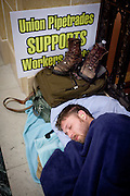 A protestor sleeps during a protest against a bill to eliminate collective bargaining at the State Capitol in Madison, Wisconsin, February 24, 2011.
