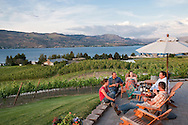 A group of winemakers enjoys an evening BBQ at Nefarious Cellars and Vineyards overlooking Lake Chelan, Washington