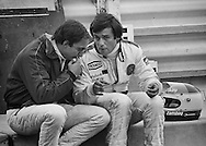 American Wolf-Ford F1 driver Bobby Rahal and France's Marlboro Lowenbrau McLaren-Ford driver Patrick Tambay share stories and advice during a lull in practice for the 1978 US Grand Prix at Watkins Glen, NY. <br /> <br /> Rahal and Tambay had a friendship that went back to their North American Can-Am series competition as well as their common experiences with Carl Haas Racing, Formula Atlantic and Formula 2. <br /> <br /> When Rahal was given to opportunity to partner with Jody Scheckter as second driver for the Walter Wolf-Ford F1 team during the final two races of the season in Canada and the United Staes, good friend Tambay was there to share, caution and cajole Rahal as to the more delicate aspects of a Formula One car and Formula One life. <br /> <br /> Tambay would go on to finish 6th, while Rahal would finish a commendable 12th.<br /> <br /> Two of Three