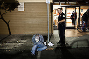 Sacramento Police Department Officer Jon Gresham watches a suspect after finding him in possession of methamphetamine during the graveyard shift on  October 26, 2012 in Sacramento, Calif. Budget cuts have decimated the Sacramento Police Department resulting in the elimination of many investigative units.