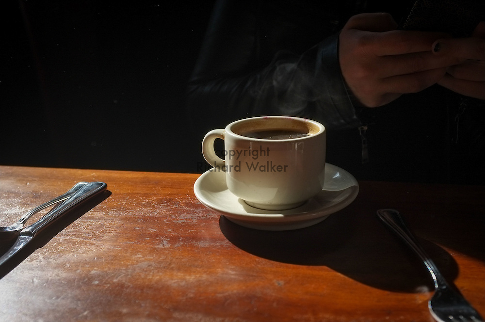 2016 October 22 - Cup of coffee on a table, backlit, Seattle, WA, USA. By Richard Walker