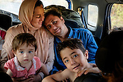 Esmael (husband) and Saheb Zade (wife) Bashira with their children, inside the car that picked them up after they were walking many hours trying to reach Mytilene city. <br /> They are from Kabul in Afghanistan where the husband had a street stall selling clothes. After an explosion near their home killed her nephew who was a policeman, they got scared and decided to leave the country. They want to go to Switzerland.