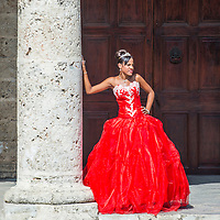 HAVANA, CUBA - JULY 18 : Cuban woman with red dress in old Havana street on July 18 2016. The historic center of Havana is UNESCO World Heritage Site since 1982.