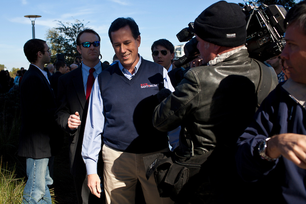 Republican presidential candidate Rick Santorum is surrounded by media after a campaign event on Thursday, January 19, 2012 in Mt. Pleasant, SC.