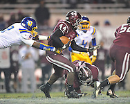 Oxford High's Darius Liggins (9) tackles Picayune's Daveon Greene in the MHSAA Class 5A championship game at Mississippi Veterans Memorial Stadium in Jackson, Miss. on Saturday, December 7, 2013.