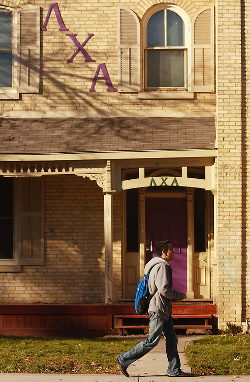 London, Ontario ---10-11-12--- A man passes by the Lambda Chi Alpha fraternity house in downtown London, Ontario, November 12, 2010<br /> GEOFF ROBINS The Globe and Mail