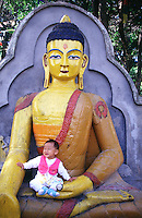 This little baby wasn't too happy about being in the lap of Buddha but it made for a great photo opportunity. Swayambunath Temple, Kathmandu, Nepal.