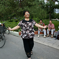 """SHIHEZI, JULY-16 :Yue Caiying had trained to be a nurse in Gansu province but after arriving in Shihezi, worked cleaning streets and scouring toilets. """"I was a model worker, which made me very happy,"""" she said."""