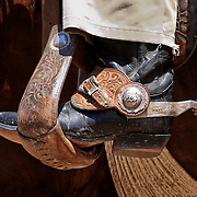 The boots, spurs, and chaps are functional pieces of equipment used every day by the American cowboy. As well as being functional they can be quite decorative and the spurs are often inlayed with silver or gold. These silver and gold spurs belong to Harry Vold, world famous rodeo stock contractor.