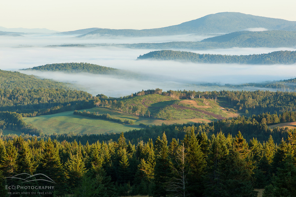 Fog in the Connecticut River Valley as seen from a hilltop farm in Stewartstown, New Hampshire.