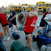 Members of the MOC-Floyd Valley High School band arrive in Ankeny for the Mid Iowa Band Championships.  Their schedule became hectic when one of their busses broke down enroute from Vermillion, S.D., where earlier in the day they had competed in another band festival.  After a short rest and warm-up period, they took the field at Ankeny High School and won their third straight 3A championship.