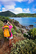 356201-1019 ~ Copyright:  George H. H. Huey ~ Hiker on the Yawzi Point Trail, looking across Great Lameshur Bay, southeast coast of St. John Island, U.S. Virgin Islands National Park.  Caribbean. Release #127