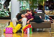 Kierra Wing and Nate Addie Take a nap while in the midst of Black Friday shopping at Fashion Show Mall on Friday, November 27, 2015.  L.E. Baskow