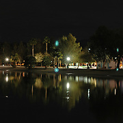 Reflections of the walkway lights and a park lights on one of the waterways in Lake Havasu City, Arizona.