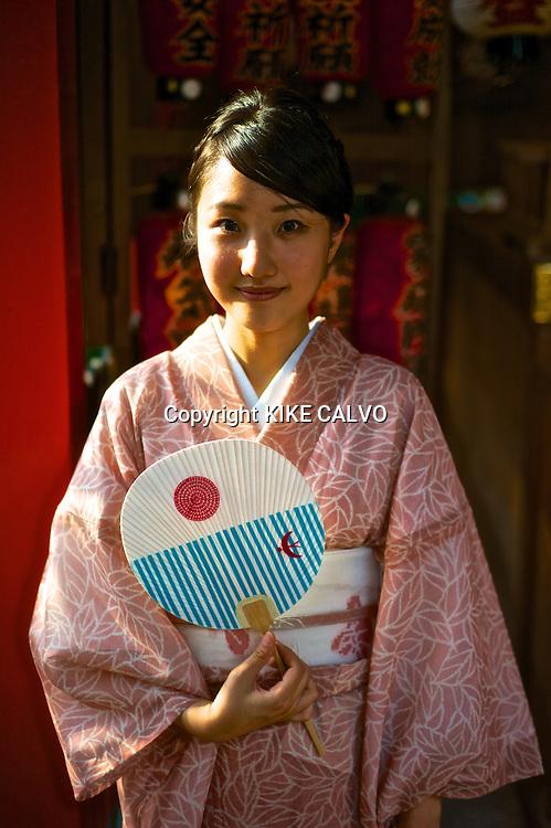 Asian woman wearing traditional kimono at the Kiyomizu Temple.