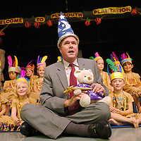 11/20/06--Tampa--Governor Jeb Bush receives an honorary wizard hat and wizard bear from Susan Mikolajczyk's kindergarten class at Westchase Elementary after watching the class perform a Thanksgiving program. The school's mascot is a wizard making Governor Bush an honorary wizard. Photo by Julie Busch Branaman