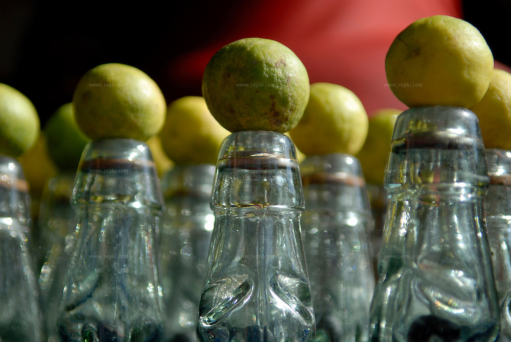 Bottles of lime soda on display at a road side stall in Rishikesh, India.