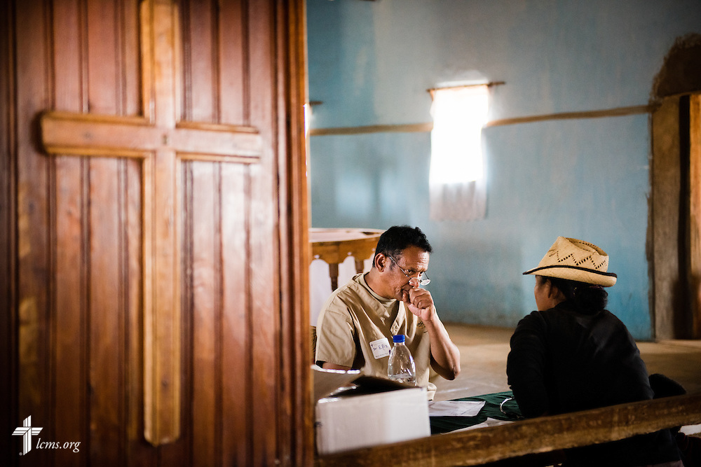A member of the Mercy Medical Team treats a patient Saturday, Oct. 18, 2014, at a Fiangonana Loterana Malagasy (FLM) Lutheran church in Antsoantany, Madagascar. LCMS Communications/Erik M. Lunsford
