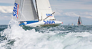 The french yacht SMA at the start of the 90th anniversary Rolex Fastnet Race on the Solent. A record fleet of 370 yachts will compete to win the Fastnet Challenge Cup.<br /> The 600 nautical mile race starts in Cowes, Isle of Wight, heading to the Fastnet Rock off the south west coast of Ireland and finishes in Plymouth.<br /> It is the world's biggest offshore race with 75% amateur sailors and professional yachtsmen competing against each other. <br /> Picture date Sunday 16th August, 2015.<br /> Picture by Christopher Ison. Contact +447544 044177 chris@christopherison.com