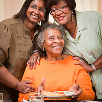 Ada Johnson and her daughters share lunch at Ada's home in east Anchorage