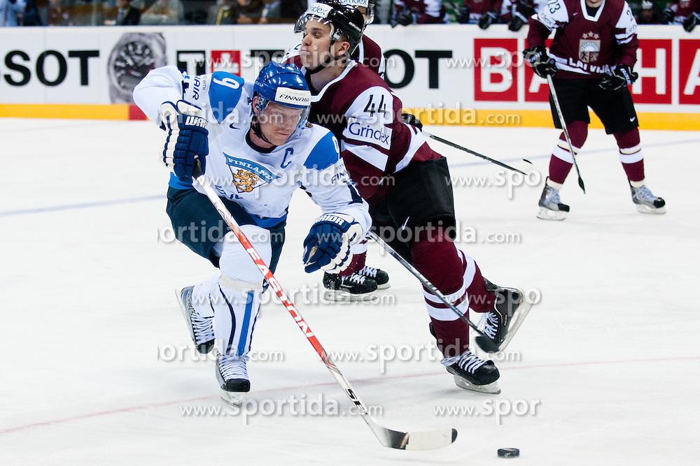 Mikko Koivu of Finland vs Oskars Cibulskis of Latvia during ice-hockey match between Latvia and Finland of Group D of IIHF 2011 World Championship Slovakia, on May 2, 2011 in Orange Arena, Bratislava, Slovakia. (Photo by Matic Klansek Velej / Sportida)