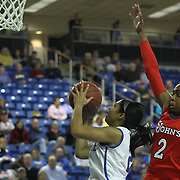 Delaware Guard Courtni Green (2) drives to the basket as St. John's Forward Amber Thompson (2) defends in the first half of a NCAA regular season non-conference game between Delaware (CAA) and St. John's (Big East) Monday, Dec 30, 2013 at The Bob Carpenter Sports Convocation Center in Newark Delaware.