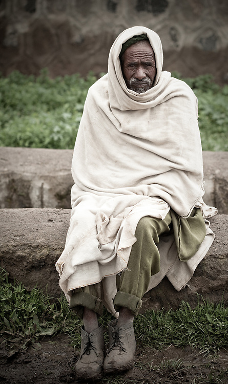 Old man wrapped in a blanket in Mehal Meda on the Guassa Plateau, Ethiopian Highlands