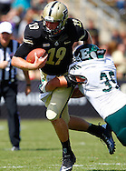 WEST LAFAYETTE, IN - SEPTEMBER 15:  Quarterback Caleb TerBush #19 of the Purdue Boilermakersruns the ball as linebacker Colin Weingrad #35 of the Eastern Michigan Eagles makes the tackle at Ross-Ade Stadium on September 15, 2012 in West Lafayette, Indiana. (Photo by Michael Hickey/Getty Images)***Local Caption***Caleb TerBush; Colin Weingrad