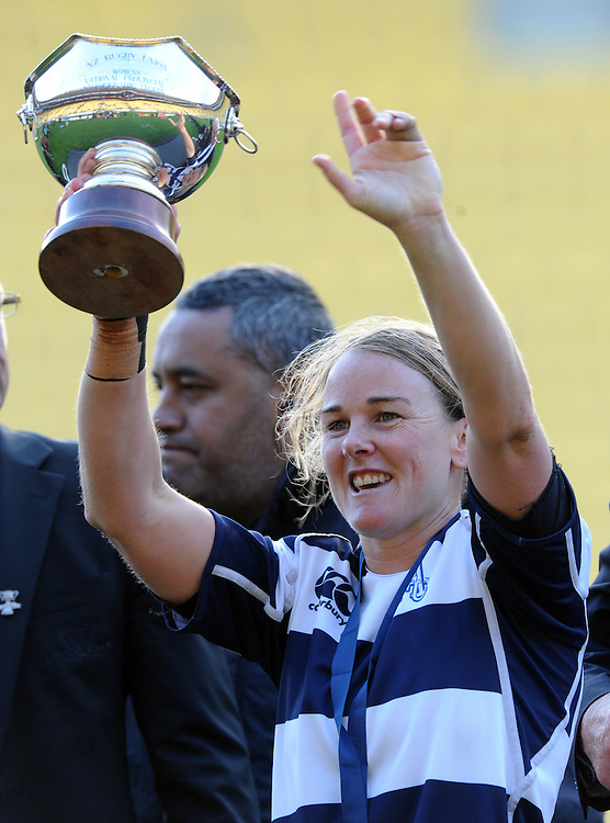 Auckland captain Emma Jensen holds the trophy aloft after her team defeated Canterbury in the Women's National Provincial Rugby Final at Westpac Stadium, Wellington, New Zealand, Saturday, October 26, 2013. Credit:SNPA / Ross Setford