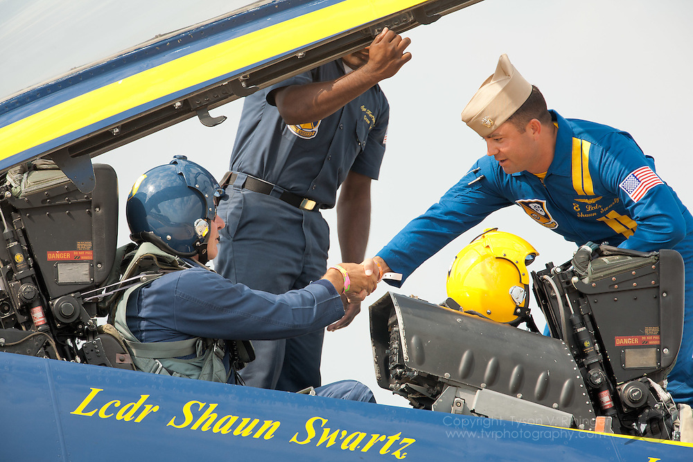 Harrison Ford gets strapped in to Blue Angel #7 by U.S. Marine Corps Staff Sgt. Deo Harrypersaud for a brief demonstation flight flown by Lt. Kevin 'Kojak' Davis at Airventure 2008 in Oshkosh, Wisconsin. Here he can be seen shaking hands with LCDR Shaun Swartz prior to his flight.