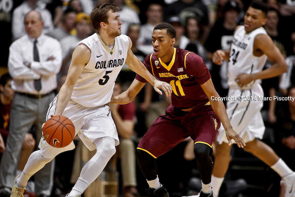 SHOT 2/19/14 10:44:56 PM - Colorado's Eli Stalzer #5 tries to drive past Arizona State's Calaen Robinson #11 during their regular season Pac-12 basketball game at the Coors Events Center in Boulder, Co. Colorado won the game 61-52.<br /> (Photo by Marc Piscotty / &copy; 2014)