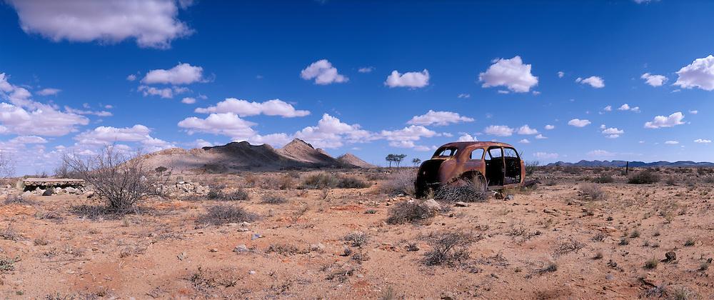 Africa, Namibia, Abandoned 1940's Nash car rusts in Namib Desert near town of Signalburg.