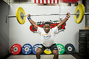 """BEAUFORT, SC - JULY 14: CJ Cummings practices his snatch, clean and jerk at Cross Fit Beaufort while training with weightlifting coach Ray Jones on July 14, 2014 in Beaufort, South Carolina. A former U.S. Olympic coach has called Cummings """"the best weightlifter this country has ever seen."""" (Photo by Stephen B. Morton for The Washington Post)"""