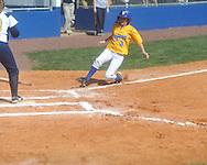 Oxford High's Allison Lyon (3) scores vs. Olive Branch in girls high school softball in Oxford, Miss. on Saturday, February 26, 2011.