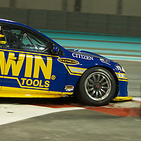 alex davidson (irwin racing) negociating a turn during YAS V8 400  in yas marina circuit, abu dhabi UAE.11 february 2011.winners Jamie Whincup - team vodaphone (1), Alex davidson - irwin racing (2), makr winterbottom - orrcon steel fpr falcon (3)...real action heroes event..Providing the action for the main event are the Australian V8 Supercars, a two-car series of makers Holden and Ford - a close rivalry that runs deep in Australian culture. This season, that rivalry is heightened by the switch of 2010 series Champion James Courtney, who drives with the coveted No.1 plate, from his winning 2010 Ford Falcon to the Holden Commodore for 2011.