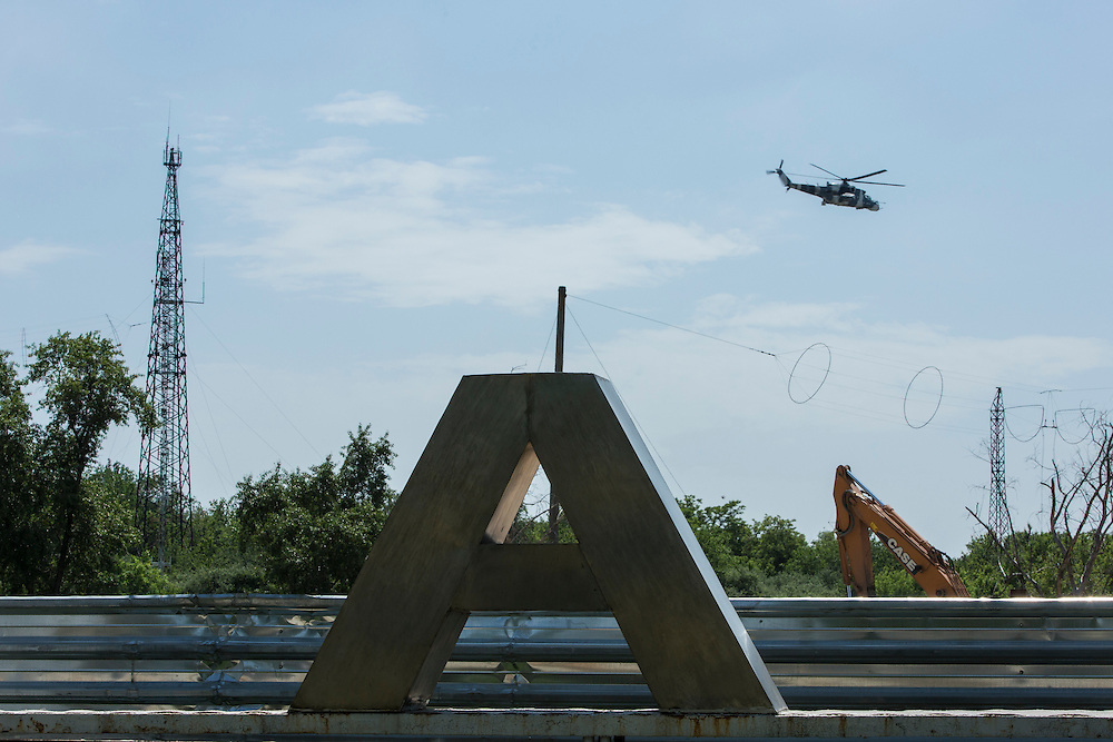 DONETSK, UKRAINE - MAY 26: A helicopter flies low over the Donetsk airport, scene of an hours-long battle between pro-Russian separatists and Ukrainian forces, on May 26, 2014 in Donetsk Ukraine. A day after businessman Petro Poroshenko won Ukraine's presidential election, separatists occupied the airport, leading to a military response. (Photo by Brendan Hoffman/Getty Images)