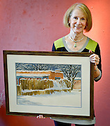mkb102114i/arts/Marla Brose/102114<br /> Susan Seligman Kennedy holds up one of her watercolors, &quot;Winter's Blanket&quot;. Kennedy will show her work in the Weems International Artfest. (Marla Brose/Albuquerque Journal)