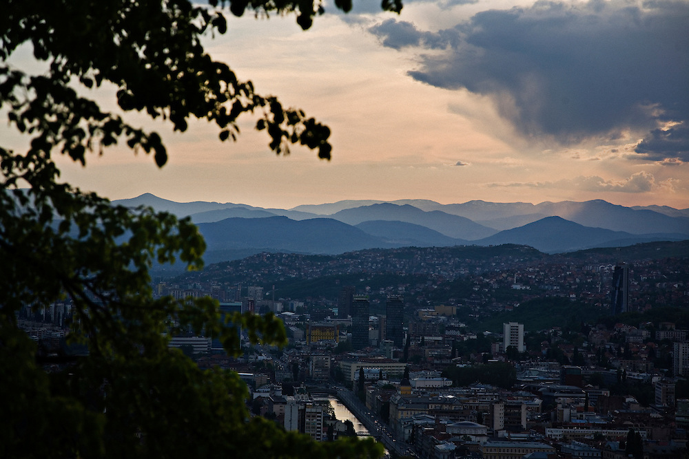 An overview of downtown Sarajevo, Bosnia and Herzegovina from the famous hilltop cafe Biban. The hills, while beautiful year-round and a signature of this important European captial, were the front lines during the 4-year Siege of Sarajevo.