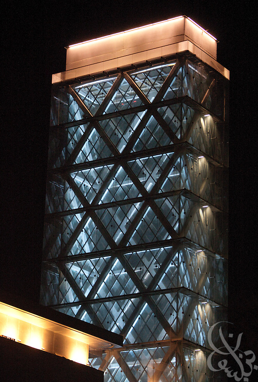 A King Abdullah University of Science and Technology (KASUT) Solar Cooling Tower is illuminated at night. The tower uses the sun and prevailing winds to create a passive pressure difference and continuous breeze along shaded courtyards. Design elements like the Solar cooling towers are part of the reason the KAUST University campus have been awarded the LEED Platinum designation, a distinguished recognition of environmentally sustainable design, construction and operation of buildings.