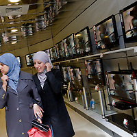 Palestinian women look at LCD TV in the show room of the biggest householp aplliance  store in the West Bank...Photo by Olivier Fitoussi