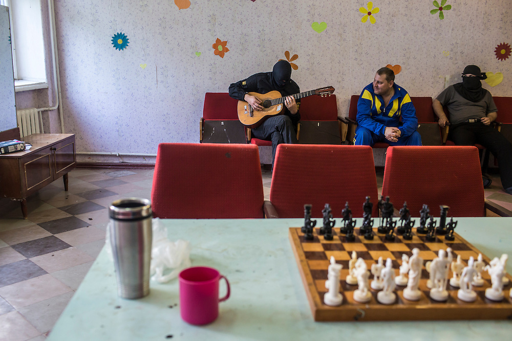 DNIPROPETROVSK REGION, UKRAINE - MAY 19: Members of the Donbass Battalion, a pro-Ukrainian militia, relax in their barracks on May 19, 2014 in Dnipropetrovsk Region, Ukraine. A week before presidential elections are scheduled, questions remain whether the eastern regions of Donetsk and Luhansk are stable enough to administer the vote. (Photo by Brendan Hoffman/Getty Images) *** Local Caption ***