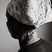 A portrait of Mukagatare, a woman who was attacked with machetes by Hutu Militia during the 1994 Rwandan Genocide.  The men chopped her neck then left her for dead.